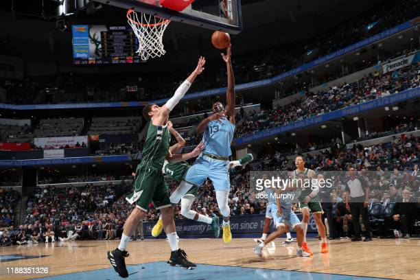 Jaren Jackson Jr #13 of the Memphis Grizzlies shoots the ball against the Milwaukee Bucks on December 13 2019 at FedExForum in Memphis Tennessee NOTE...