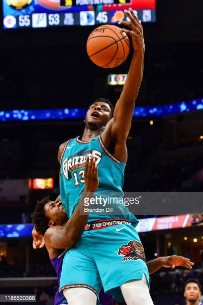 Jaren Jackson Jr #13 of the Memphis Grizzlies struggles for control of the ball against Ed Davis of the Utah Jazz during the second half at...