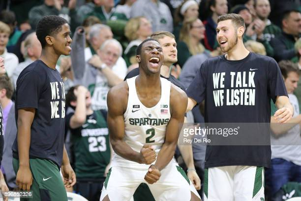 Jaren Jackson Jr #2 of the Michigan State Spartans celebrates from the bench during the game against the Long Beach State 49ers at Breslin Center on...