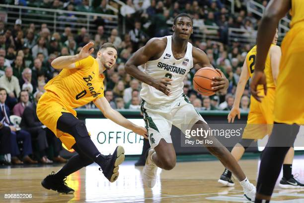Jaren Jackson Jr #2 of the Michigan State Spartans drives to the basket against Gabe Levin of the Long Beach State 49ers at Breslin Center on...
