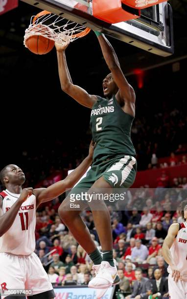 Jaren Jackson Jr. #2 of the Michigan State Spartans dunks the ball in the second half as Eugene Omoruyi of the Rutgers Scarlet Knights defends on...