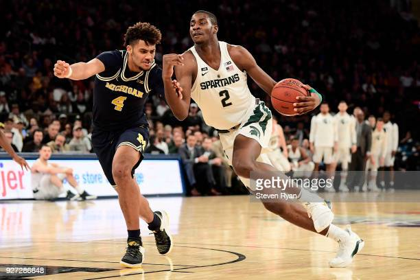 Jaren Jackson Jr #2 of the Michigan State Spartans is defended by Isaiah Livers of the Michigan Wolverines during the semifinals of the Big Ten...