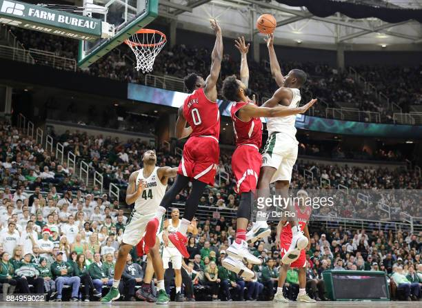 Jaren Jackson Jr #2 of the Michigan State Spartans shoots overs Isaac Copeland of the Nebraska Cornhuskers at Breslin Center on December 3 2017 in...