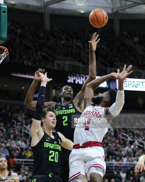 Jaren Jackson Jr blocks the shot of Robert Johnson of the Indiana Hoosiers at Breslin Center on January 19 2018 in East Lansing Michigan