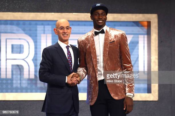 Jaren Jackson Jr poses with NBA Commissioner Adam Silver after being drafted fourth overall by the Memphis Grizzlies during the 2018 NBA Draft at the...