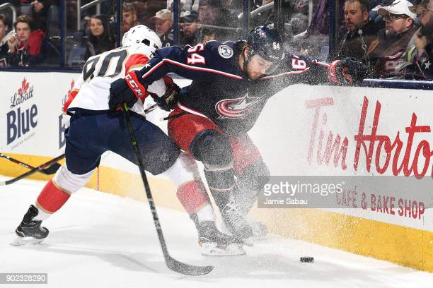 Jaren McCann of the Florida Panthers and Tyler Motte of the Columbus Blue Jackets battle for control of the puck in the first period on January 7...