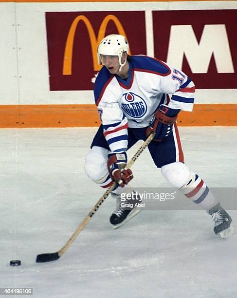 Jari Kurri of the Edmonton Oilers controls the puck against the Toronto Maple Leafs during NHL game action on February 20 1986 at Northlands Coliseum...