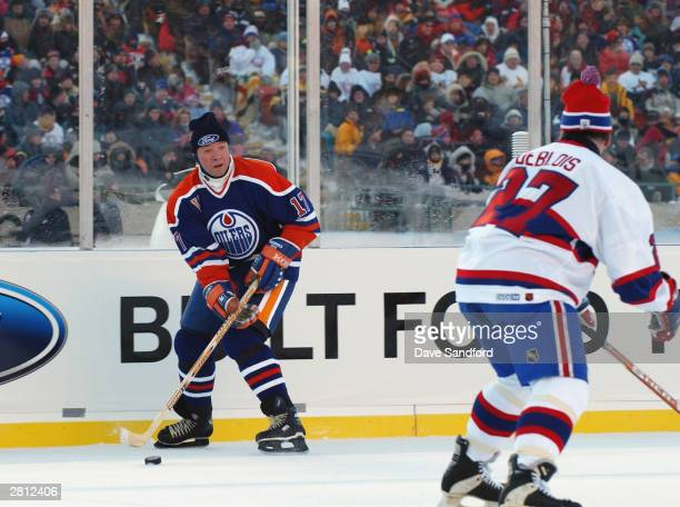 Jari Kurri of the Edmonton Oilers looks to make a play against Lucen Deblois of the Montreal Canadiens during the Molson Canadien Heritage Classic on...