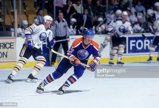 Jari Kurri of the Edmonton Oilers skates on the ice during an NHL game against the Buffalo Sabres circa 1990 at the Buffalo Memorial Auditorium in...