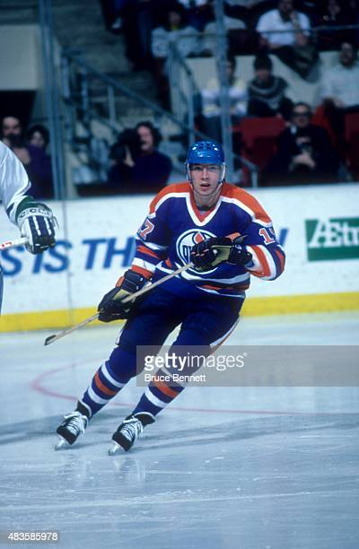 Jari Kurri of the Edmonton Oilers skates on the ice during an NHL game against the Hartford Whalers circa 1990 at the Hartford Civic Center in...