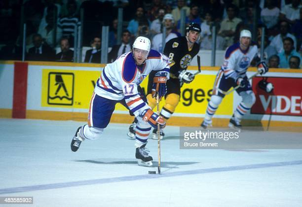 Jari Kurri of the Edmonton Oilers skates with the puck during the 1988 Stanley Cup Finals against the Boston Bruins in May 1988 at the Northlands...
