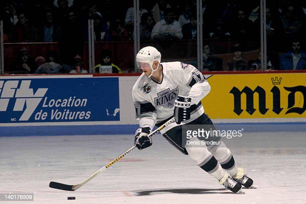 Jari Kurri of the Los Angeles Kings skates with the puck during a game against the Montreal Canadiens Circa 1990 at the Montreal Forum in Montreal...