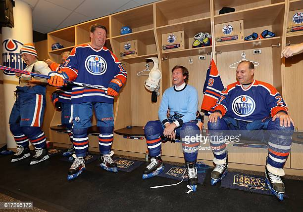 Jari Kurri Wayne Gretzky and Dave Semenko of the Edmonton Oilers alumni share a laugh in the locker room before playing in the 2016 Tim Hortons NHL...