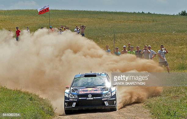 Jari Matti Latvala and codriver Miikka Anttila of Finland drive their Volkswagen Polo R WRC during the special stage at Rally Poland in Stare Juchy...
