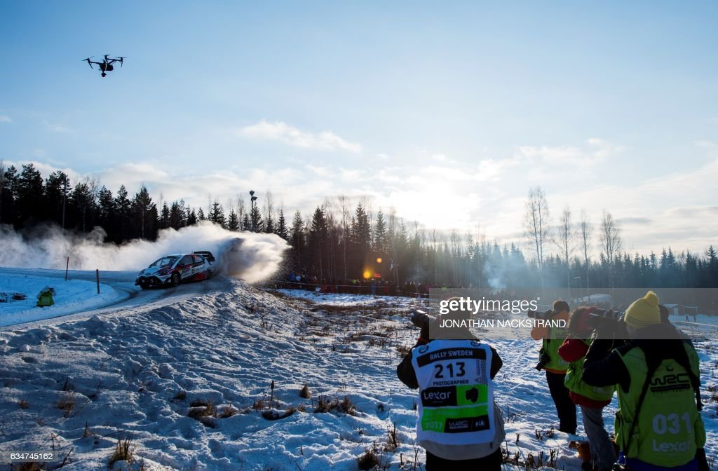 TOPSHOT - Jari Matti Latvala of Finland and his co-driver Miikka Anttila compete in their Toyota Yaris WRC during the 13th stage of the Rally Sweden, second round of the FIA World Rally Championship on February 11, 2017 in Hagfors, Sweden. / AFP PHOTO / Jonathan NACKSTRAND
