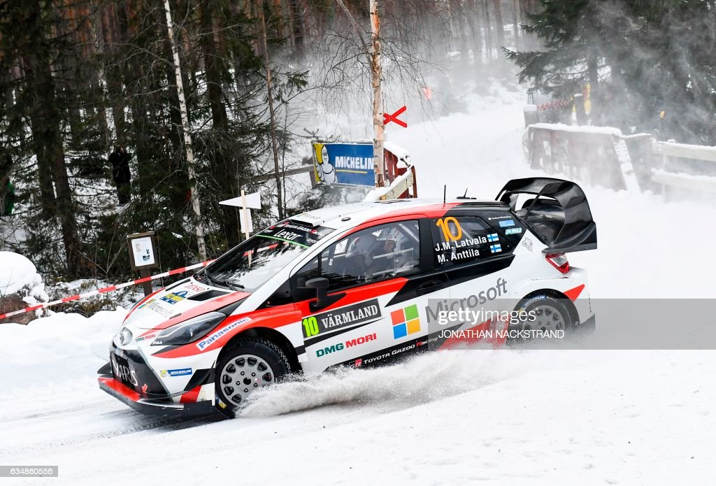 TOPSHOT - Jari Matti Latvala of Finland and his co-driver Miikka Anttila compete in their Toyota Yaris WRC during the 17th stage of the Rally Sweden, second round of the FIA World Rally Championship on February 12, 2017 in Likenas, Sweden. / AFP PHOTO / Jonathan NACKSTRAND