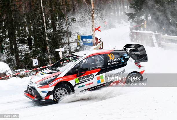 TOPSHOT Jari Matti Latvala of Finland and his codriver Miikka Anttila compete in their Toyota Yaris WRC during the 17th stage of the Rally Sweden...
