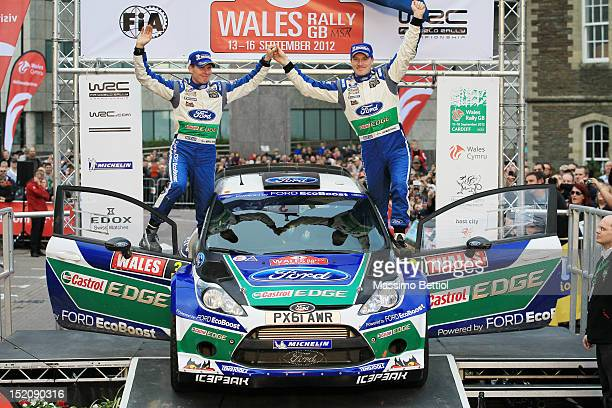 Jari Matti Latvala of Finland and Mikka Anttila of Finland are celebrating their victory during Day Three of the WRC Great Britain on September 16...