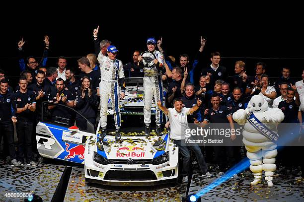 Jari Matti Latvala of Finland and Mikka Anttila of Finland celebrate their victory in the final podium of Strasbourg during Day Three of the WRC...