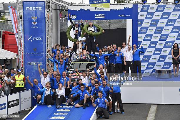 Jari Matti Latvala of Finland and Mikka Anttila of Finland celebrate their victory with the Volkswagen Motorsport WRT during Day Three of the WRC...