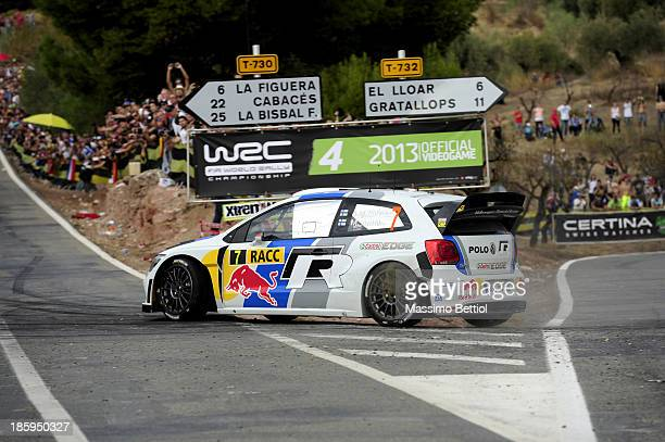 Jari Matti Latvala of Finland and Mikka Anttila of Finland compete in their Volkswagen Motorsport Polo R WRC during Day Two of the WRC Spain on...