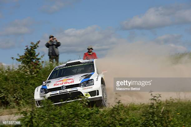 Jari Matti Latvala of Finland and Mikka Anttila of Finland compete in their Volkswagen Motorsport Polo R WRC during Day One of the WRC Poland on June...