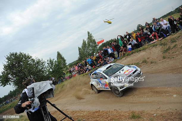 Jari Matti Latvala of Finland and Mikka Anttila of Finland compete in their Volkswagen Motorsport Polo R WRC during Day Three of the WRC Poland on...