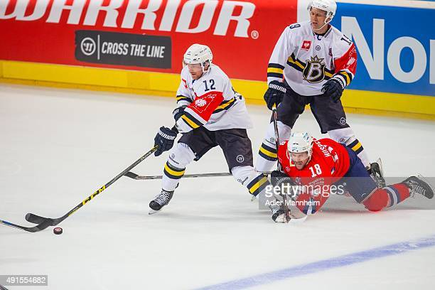 Jari Sailio of Espoo Blues in action with Kai Hospelt of Adler Mannheim during the Champions Hockey League round of thirty-two game between Adler...