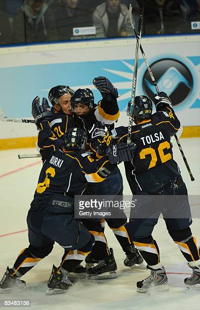 Jari Tolsa celebrates a goal with his team mates during the IIHF Champions Hockey League match between Espoo Blues and HV71 Jonkoping on October 29,...