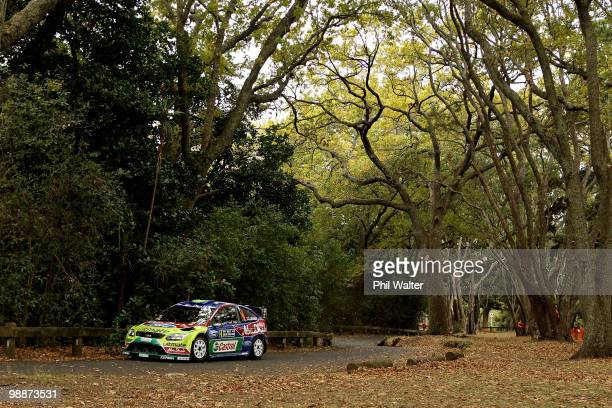 JariMatti Latvala and codriver Miikka Antilla of Finland drive their Ford Focus RS through the streets of the Auckland Domain during the WRC Rally of...