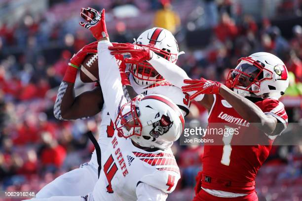 Jarius Morehead of the North Carolina State Wolfpack intercepts a pass at the goal line intended for Tutu Atwell of the Louisville Cardinals in the...