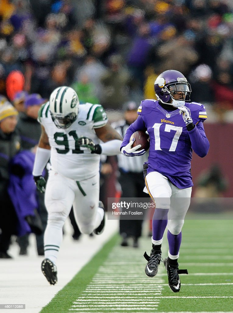 Jarius Wright #17 of the Minnesota Vikings carries the ball for a touchdown as Sheldon Richardson #91 gives chase during overtime of the New York Jets of the game on December 7, 2014 at TCF Bank Stadium in Minneapolis, Minnesota. The Vikings defeated the Jets 30-24.