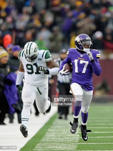 Jarius Wright of the Minnesota Vikings carries the ball for a touchdown as Sheldon Richardson gives chase during overtime of the New York Jets of the...