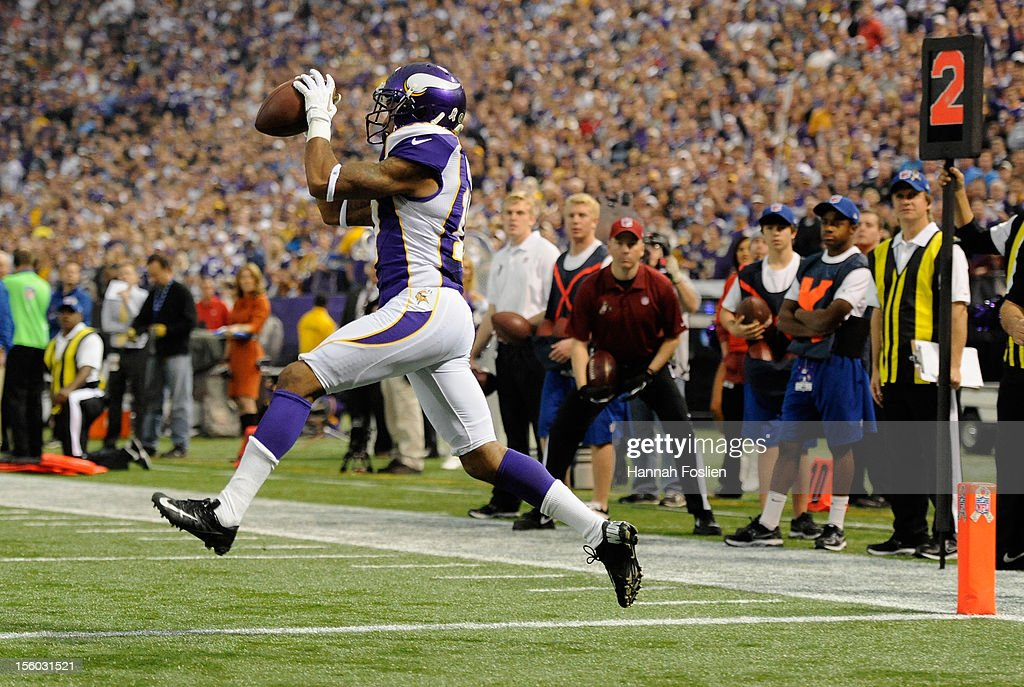 Jarius Wright #17 of the Minnesota Vikings catches the ball for a touchdown during the first quarter of the game against the Detroit Lions on November 11, 2012 at Mall of America Field at the Hubert H. Humphrey Metrodome in Minneapolis, Minnesota.