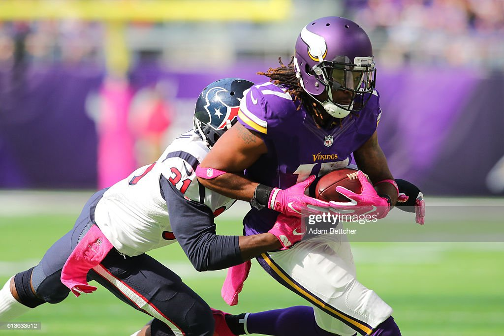 Jarius Wright #17 of the Minnesota Vikings is tackled by Charles James #31 of the Houston Texans after completing a pass during the second quarter of the game on October 9, 2016 at US Bank Stadium in Minneapolis, Minnesota.