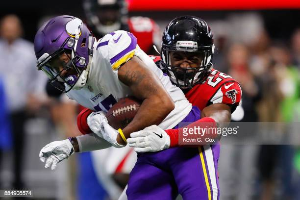 Jarius Wright of the Minnesota Vikings is tackled by Keanu Neal of the Atlanta Falcons after a catch during the first half at MercedesBenz Stadium on...