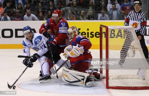 Jarkko Immonen of Finland fails to score over Konstantin Barulin , goaltender of Russi during the IIHF World Championship qualification match between...