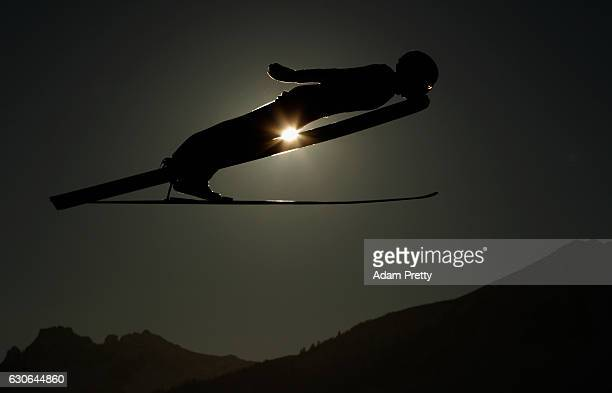 Jarkko Maeaettae of Finalnd soars through the air during his training jump on Day 1 of the 65th Four Hills Tournament ski jumping event on December...
