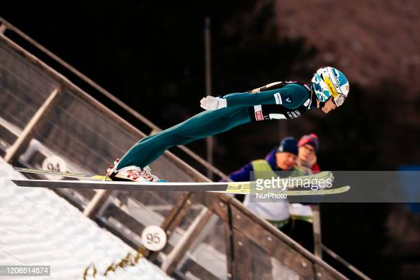 Jarkko Määttä soars in the air during the men's large hill team competition HS130 of the FIS Ski Jumping World Cup in Lahti, Finland, on February 29,...