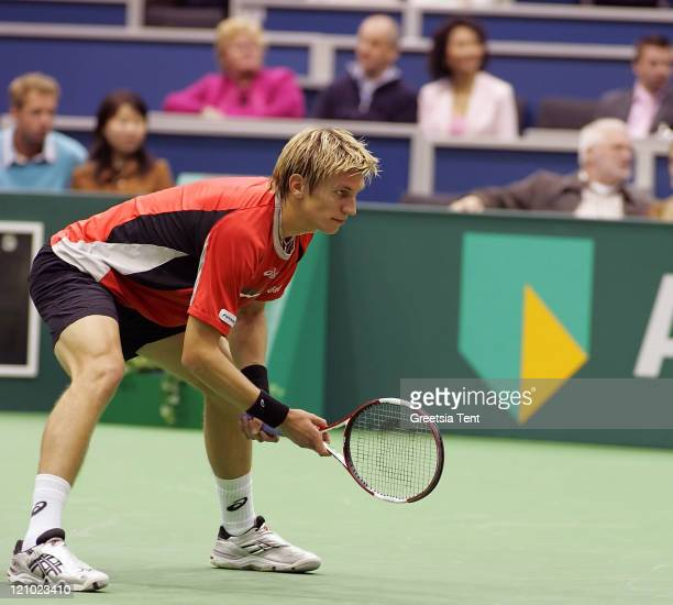 Jarkko Nieminen in action against Mario Ancic during their first round match during the ABN AMRO World Tennis Tournament at the Ahoy' in Rotterdam...