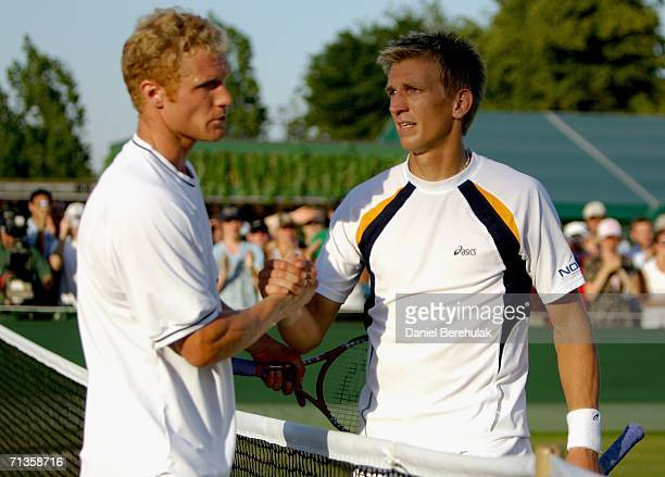 Jarkko Nieminen of Finland is congratulated by Dmitry Tursunov of Russia during day seven of the Wimbledon Lawn Tennis Championships at the All...