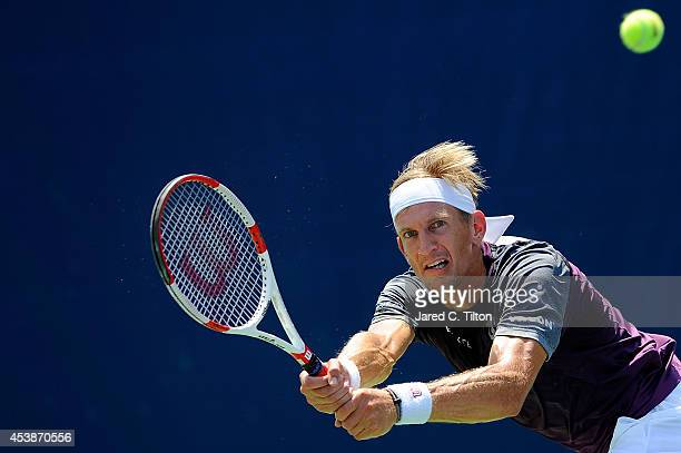 Jarkko Nieminen of Finland returns a shot from David Goffin of Belgium during the Winston-Salem Open at Wake Forest University on August 20, 2014 in...