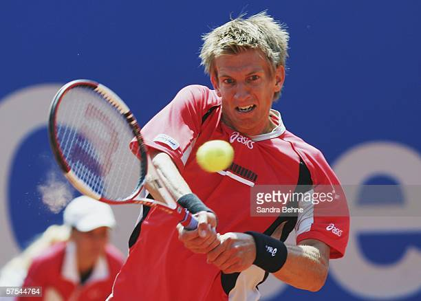 Jarkko Nieminen of Finland returns a shot to Kristof Vliegen of Belgium during the semi final at the BMW Open at the Iphitos tennis club on May 5,...