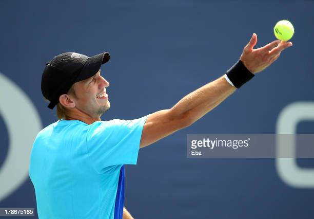 Jarkko Nieminen of Finland serves during his men's singles second round match against Joao Souza of Brazil on Day Five of the 2013 US Open at USTA...