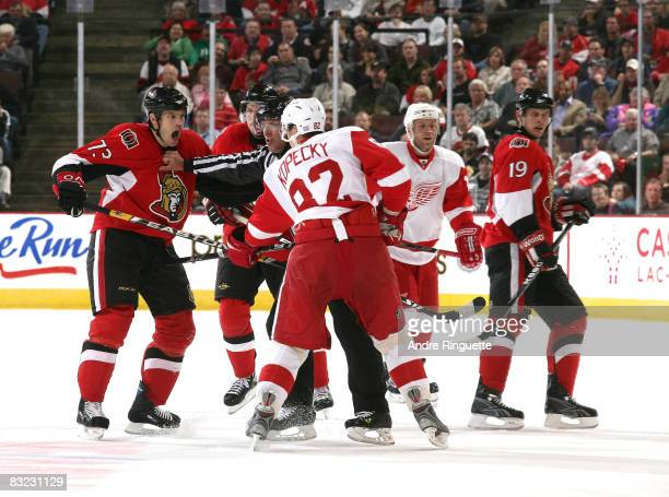 Jarkko Ruutu of the Ottawa Senators argues with Tomas Kopecky of the Detroit Red Wings at Scotiabank Place on October 11 2008 in Ottawa Ontario Canada