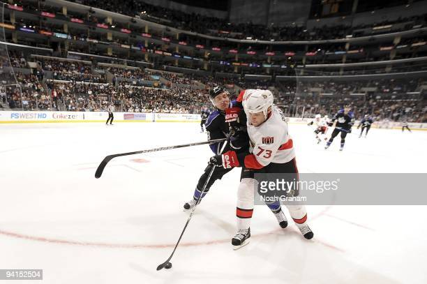 Jarkko Ruutu of the Ottawa Senators battles for the puck against Jack Johnson of the Los Angeles Kings during the game on December 3, 2009 at Staples...