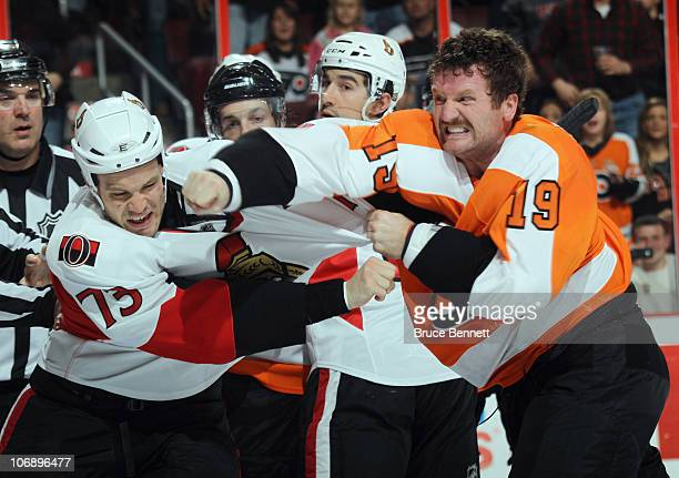 Jarkko Ruutu of the Ottawa Senators receives a punch from Scott Hartnell of the Philadelphia Flyers at the Wells Fargo Center on November 15 2010 in...