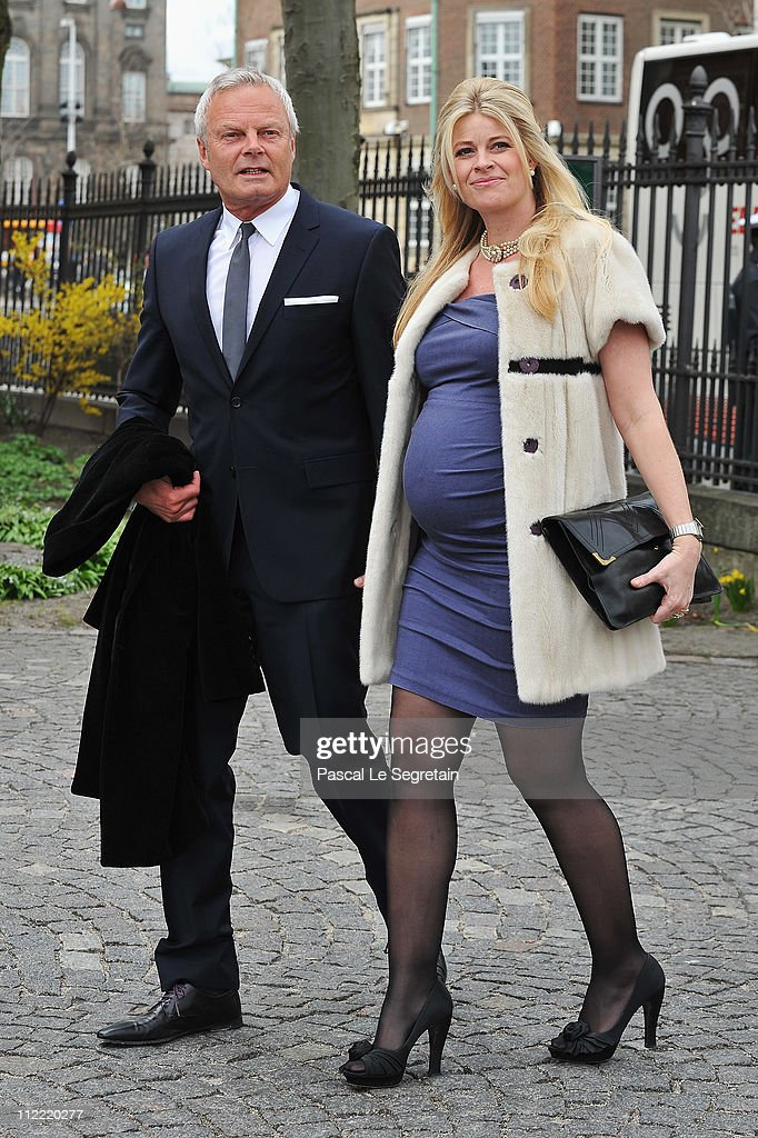 Jarl Friis Mikkelsen (L) and wife Susanne arrive to attend the christening of Crown Prince Frederik and Crown Princess Mary's twins at Holmens Kirke on April 14, 2011 in Copenhagen, Denmark.