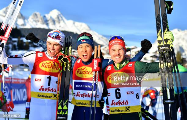 Jarl Magnus Riiber of Norway Akito Watabe of Japan and Fabian Riessle of Germany celebrate after the FIS Nordic Combined Triple world cup on January...