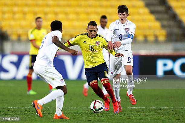 Jarlan Barrera of Colombia is challenged by Emerson Hyndman of USA during the FIFA U20 World Cup New Zealand 2015 Round of 16 match between USA and...
